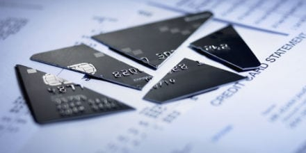 Close up of cut pieces of credit card after filing for bankruptcy