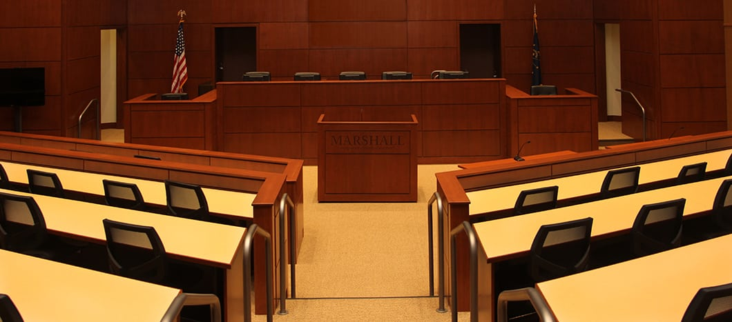 An empty courtroom before a criminal case hearing.